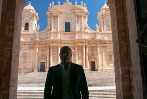 Noto Cathedral behind Inspector Montalbano